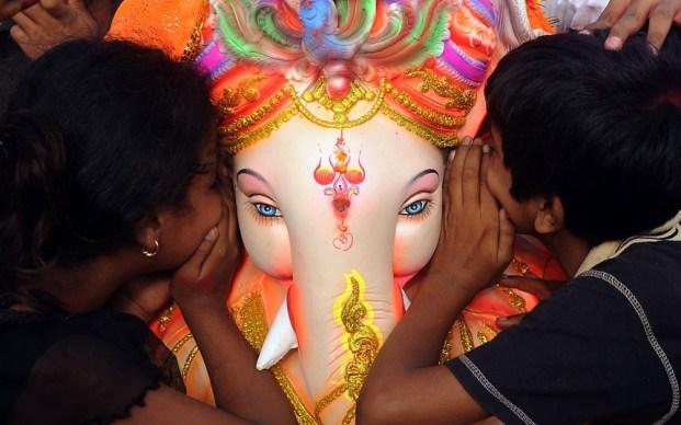 TOPSHOTS Indian Hindu devotees whisper t