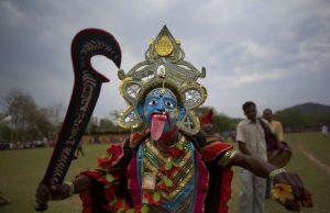 Hindu goddess Kali dances during the Suwori festival in Boko, India