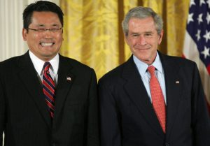 Washington, UNITED STATES: CAPTION CORRECTION - NAME US President George W. Bush smiles alongside Kay Hiramine, CEO of Private Sector Consulting in Colorado Springs, Colorado, prior to presenting him with a President's Volunteer Service Award during an event also celebrating Asian Pacific American Heritage month, 10 May 2007 in the East Room of the White House in Washington DC. AFP PHOTO/SAUL LOEB (Photo credit should read SAUL LOEB/AFP/Getty Images)