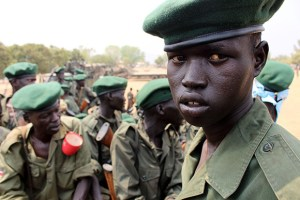 A picture taken on February 18, 2016 shows members of the Sudan People's Liberation Army (SPLA) looking on in Juba, as they begin withdrawing from the city in accordance with the terms of a peace agreement signed between the government and the opposition in August 2015. Artillery units and commandos units have redeployed out of Juba, with the rest of the units will due to withdraw starting February 19. / AFP / SAMIR BOL (Photo credit should read SAMIR BOL/AFP/Getty Images)