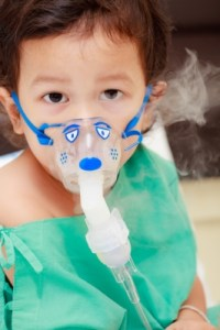 Baby with asthma inhaler