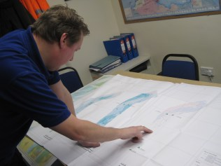 Ed Deeley, Harbour Master, looking at bathymetric surveys of the channel
