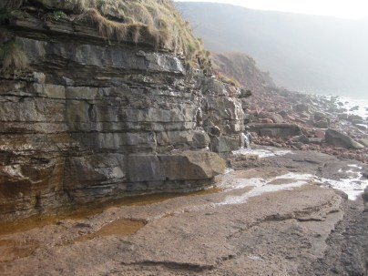 Brockram platform and low dolomitic limestone cliff