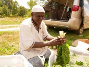Somali Bantu men with organic produce at Liberation Farms