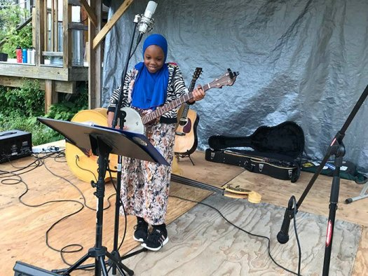 A Somali bantu girl entertaining the crowd at the Norway farmers market