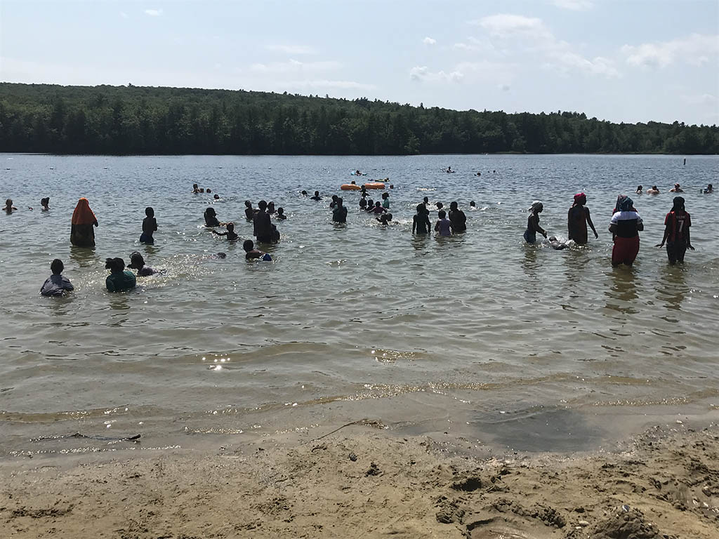 Somali Bantu people cool off at Rangely Pond