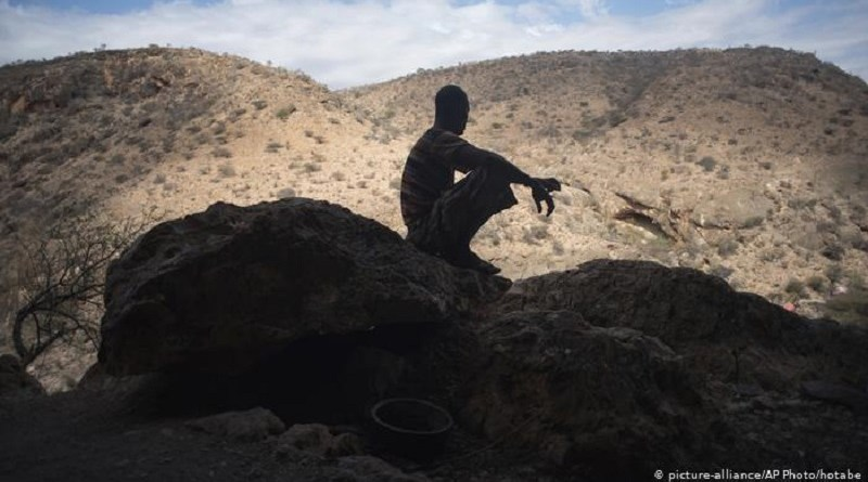 Man sitting on mountain rock in Somaliland