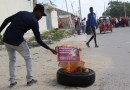 A man burns a poster of Somali President Mohamed Abdullahi Mohamed in Mogadishu in December 2020