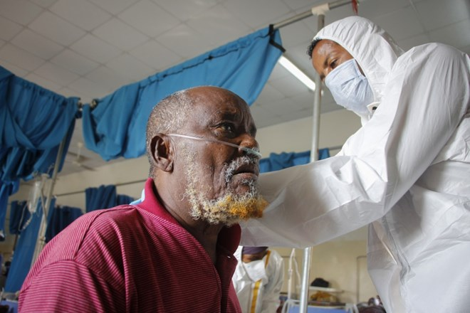 A doctor tends to a patient suffering from COVID-19 in a ward for coronavirus patients at the Martini hospital in Mogadishu
