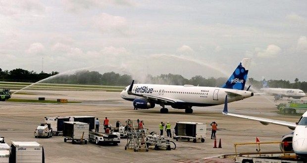 Water cannons are deployed as Jet Blue Flight 387 departs from Fort Lauderdale International Airport, for Santa Clara, Cuba, inaugurating the first regularly scheduled commercial flight between the U.S. and Cuba in more than half a century, in Fort Lauderdale, Florida August 31, 2016. REUTERS/Joe Skipper