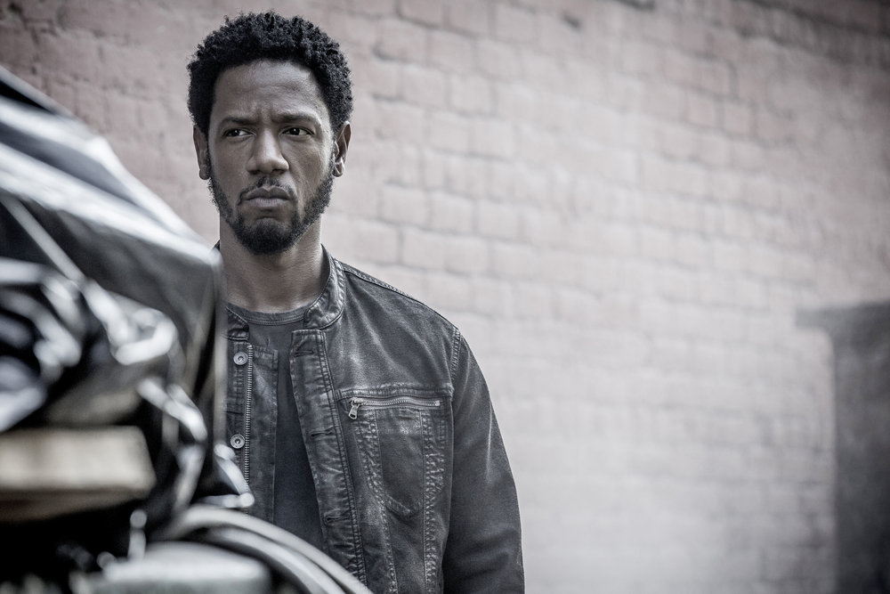 """COLONY -- """"The Garden of Beasts"""" Episode 210 -- Pictured: Tory Kittles as Broussard -- (Photo by: Isabella Vosmikova/USA Network)"""