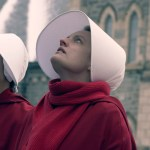 June dressed in full handmaid regalia looks up, at hanging bodies in the town square.