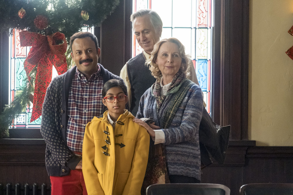 "PERFECT HARMONY -- ""Merry Jaxmas"" Episode 110 -- Pictured: (l-r) Rizwan Manji as Reverend Jax, Ayana Manji as Anjali, Tom Amandes as Luke, Kate Burton as Julie -- (Photo by: Ron Batzdorff/NBC)"