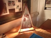 The Pyramidal Light Box, whose hollows n shadows reflect an enchanting pattern on the wall.