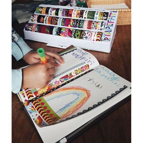 """Nieces using their """"tapeffiti"""" in my #notebook. . . . . #travelersnotebook #midoritravelersnotebook #washi #washitape"""