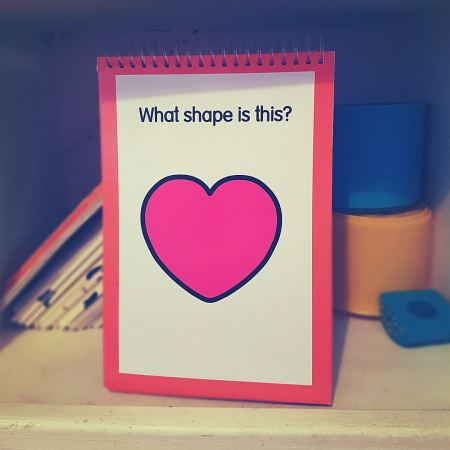 flashcard that says 'What shape is this?' with a heart shape on it