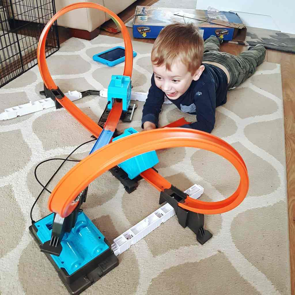 Boy plays with Hot Wheels Track Builder System. Photo by Someone's Mum