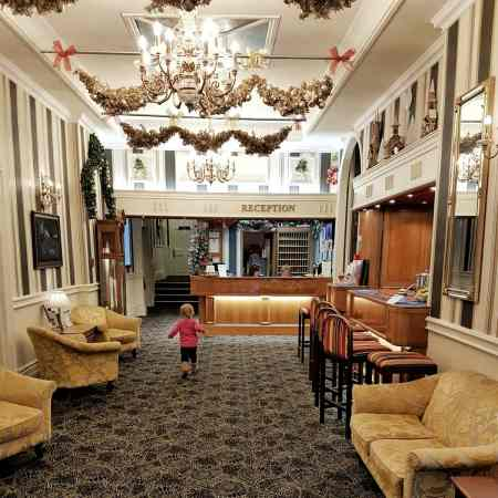Little girl running through lobby of the Langstone Cliff hotel