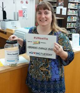 #UNSELFIE Photo of library director making a donation to the Somerset County Library for #GivingTuesday 2015
