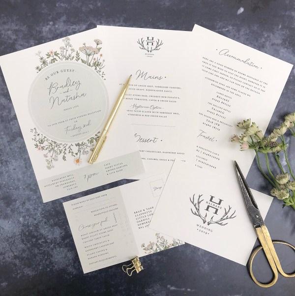 Wild flower wedding invitation flatlay