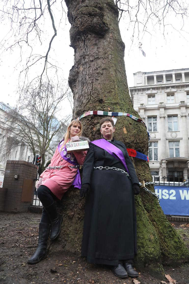 Rev Stevens tied to a tree in protest.
