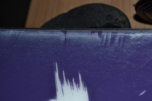 beschadigingen in een snowboard repareren
