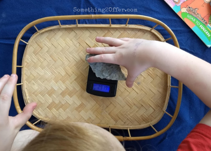 weighing fossil on gram pocket scale