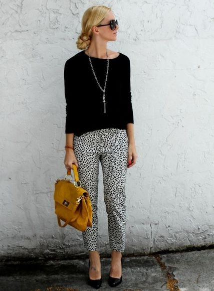printed-pants-plus-black-shirt-and-bright-bag-chic-business-casual-outfit