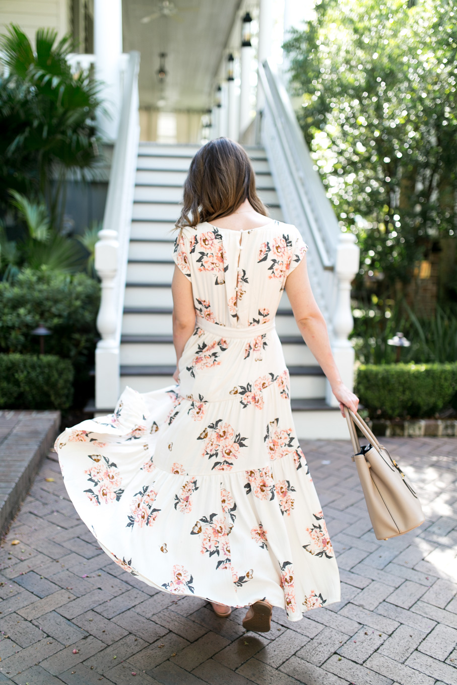Daryl-Ann Denner wearing the Free People All I got floral Maxi Dress from Nordstrom with Tory Burch Miller Flip Flops in makeup at the Zero George Hotel in Downtown Charleston, SC.