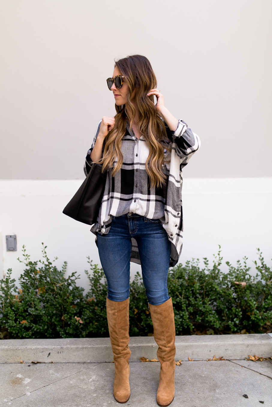 Daryl-Ann Denner wears Free People oversized plaid from Nordstrom Anniversary Sale 2017 with AG legging ankle jeans and Sam Edelman tall suede boots