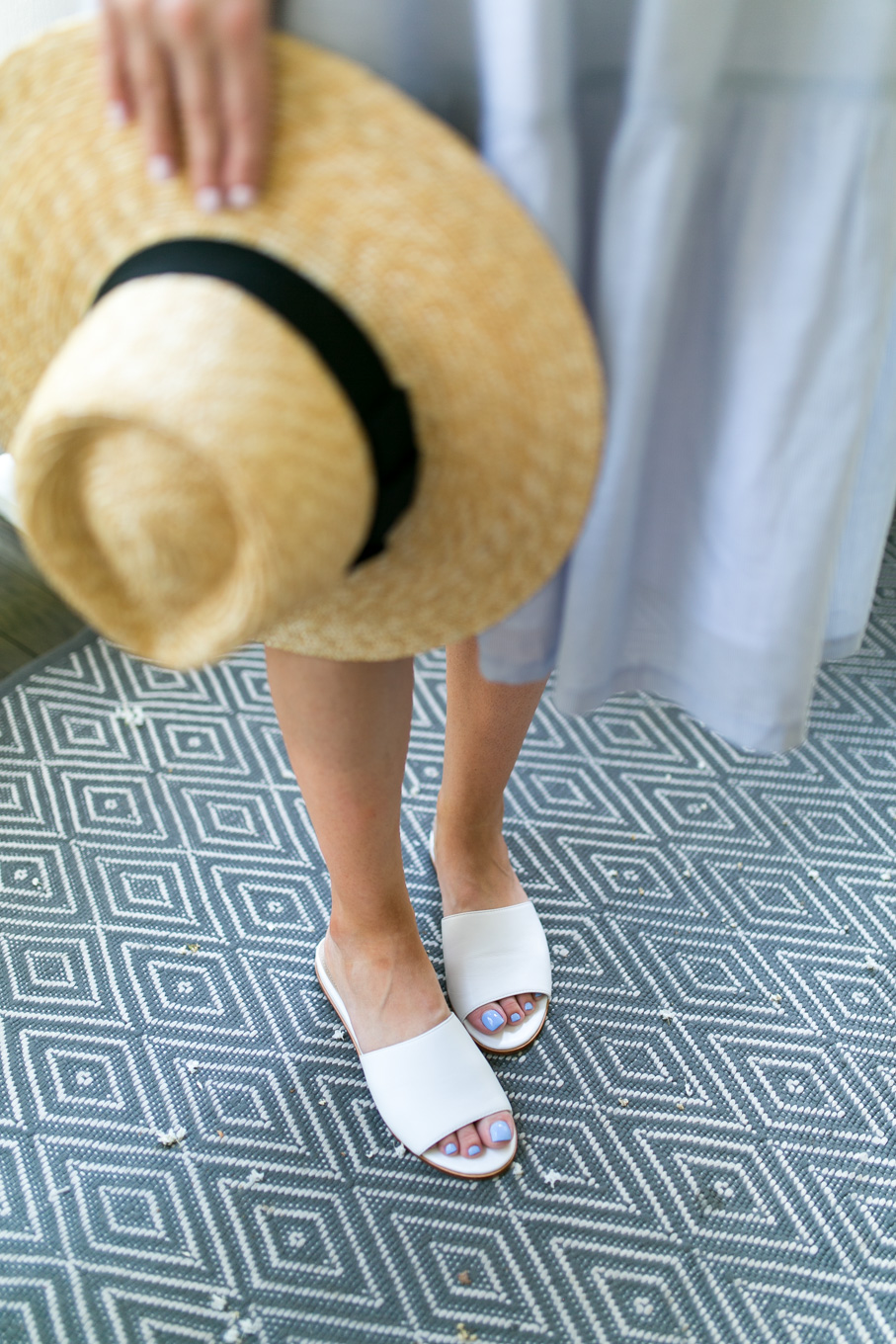 Style blogger, Daryl-Ann Denner, wears Madewell Marcelline Tiered Stripe Midi Dress, Brixton Joanna Straw hat, and Marc Fisher Wyndi White Slide Sandals from Nordstrom in Charleston
