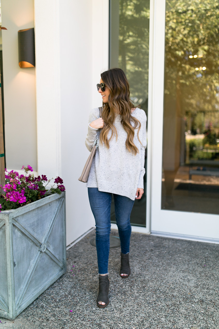 Daryl-Ann Denner wears zip-back pullover sweater from nordstrom anniversary sale 2017 with ag skinny jeans and booties