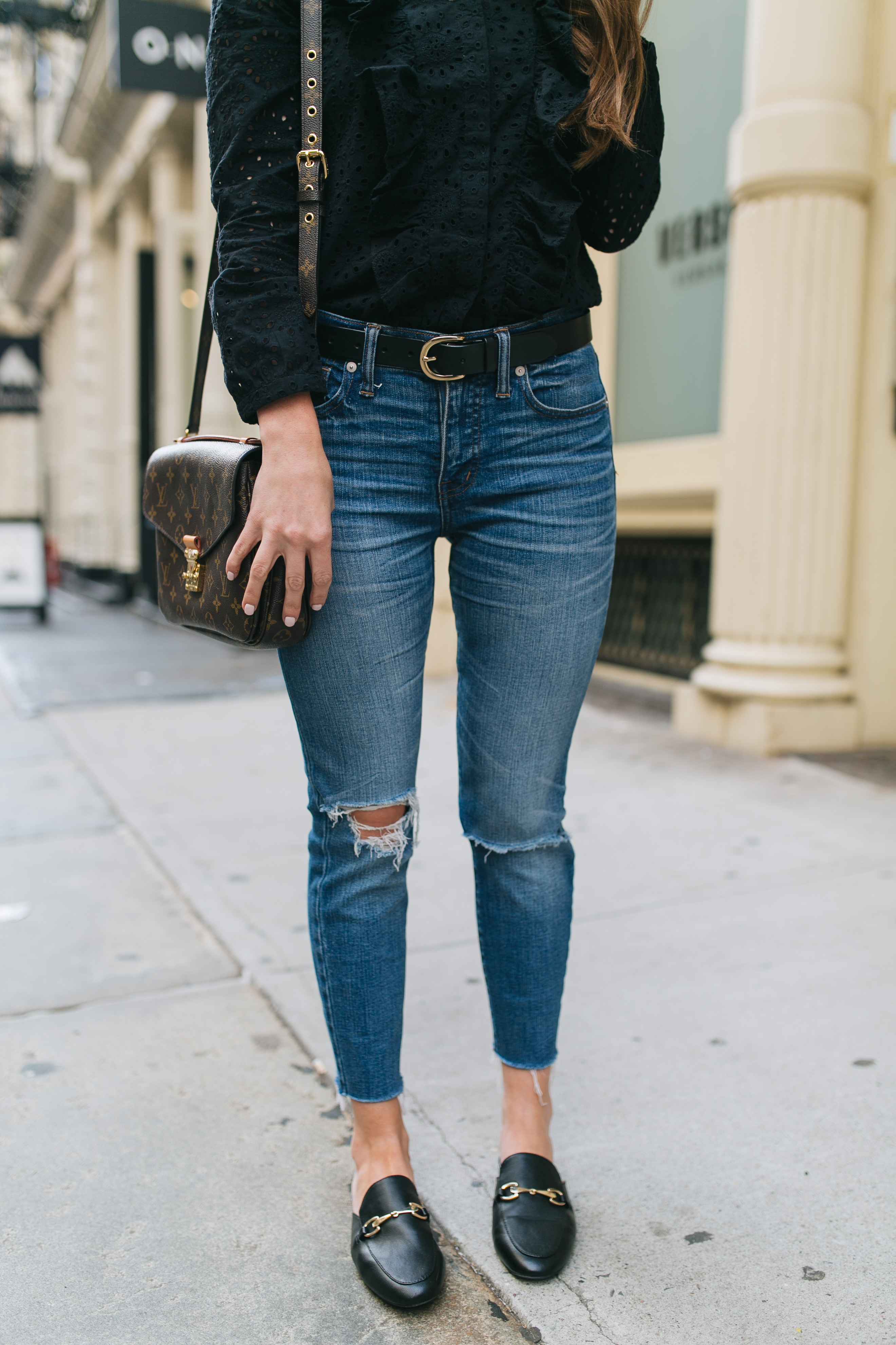 Style blogger Daryl-Ann Denner wears black eyelet ruffle top and Gucci Princetown Loafer Mule dupe for under $25
