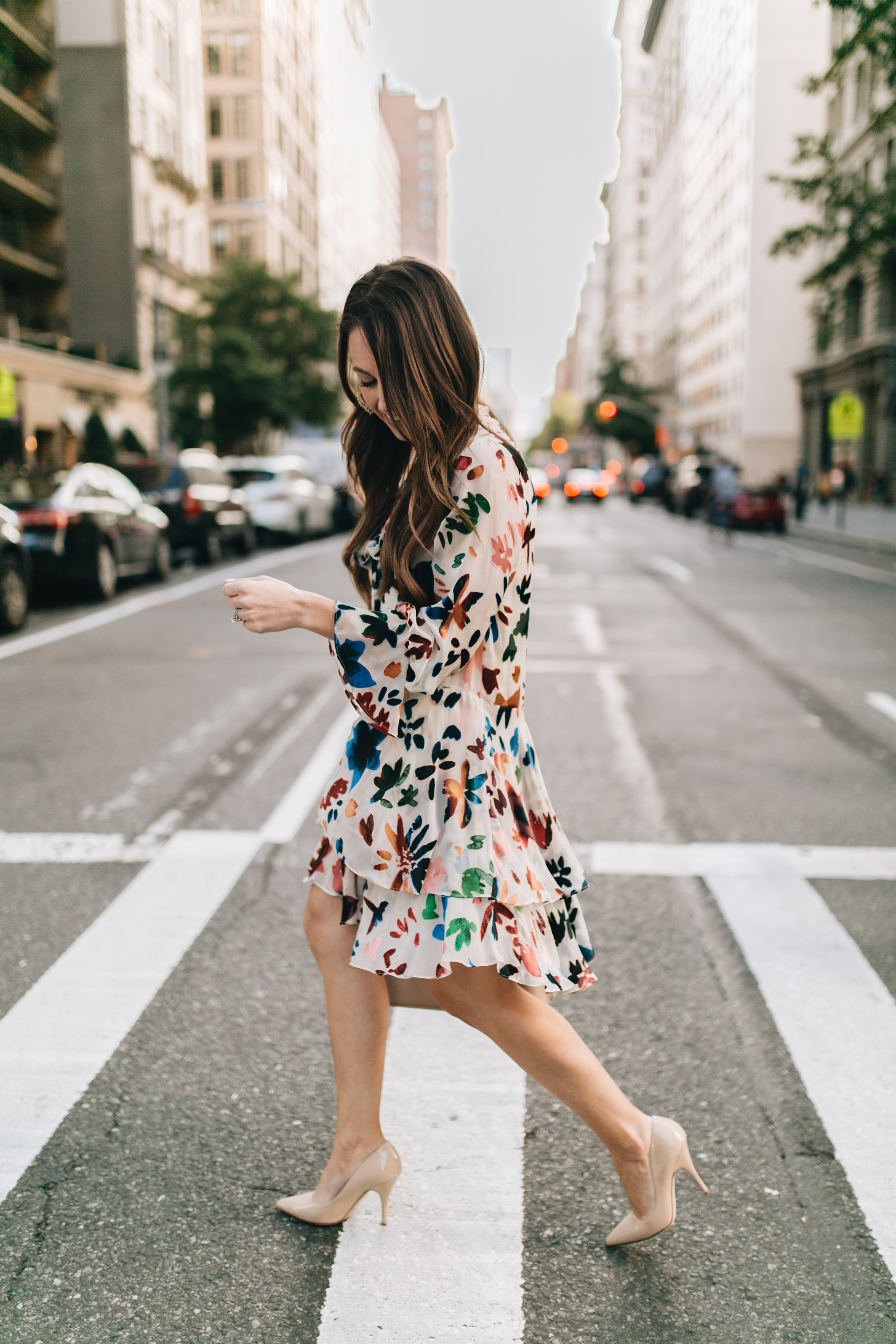 Style blogger Daryl-Ann Denner wears an Alice + Olivia dress and Kate Spade nude pumps during New York Fashion Week September 2017