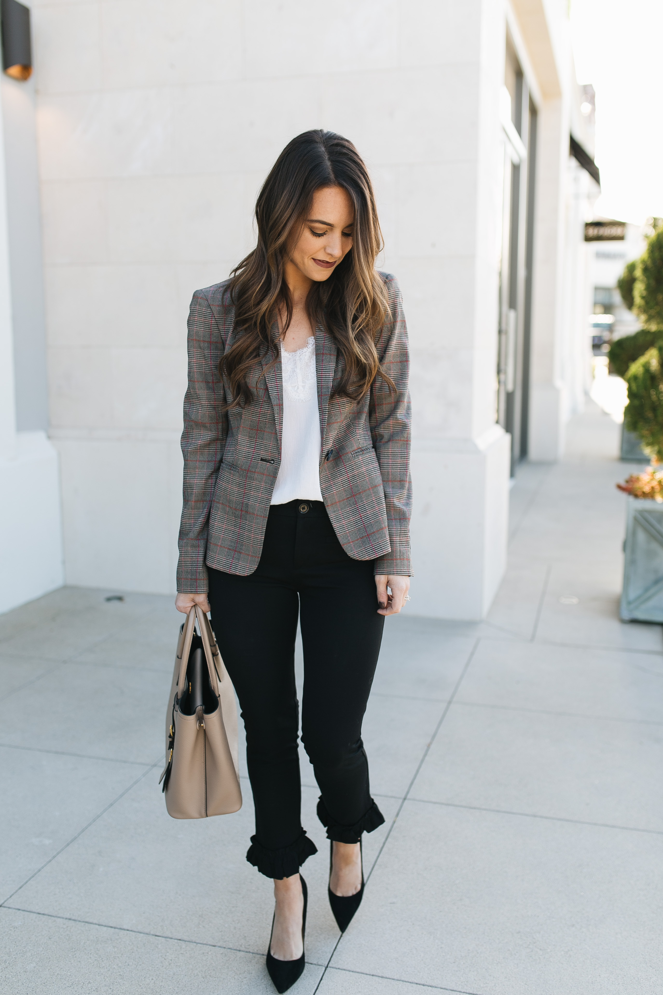 Style blogger Daryl-Ann Denner styles a plaid blazer in a work-appropriate and on-trend outfit