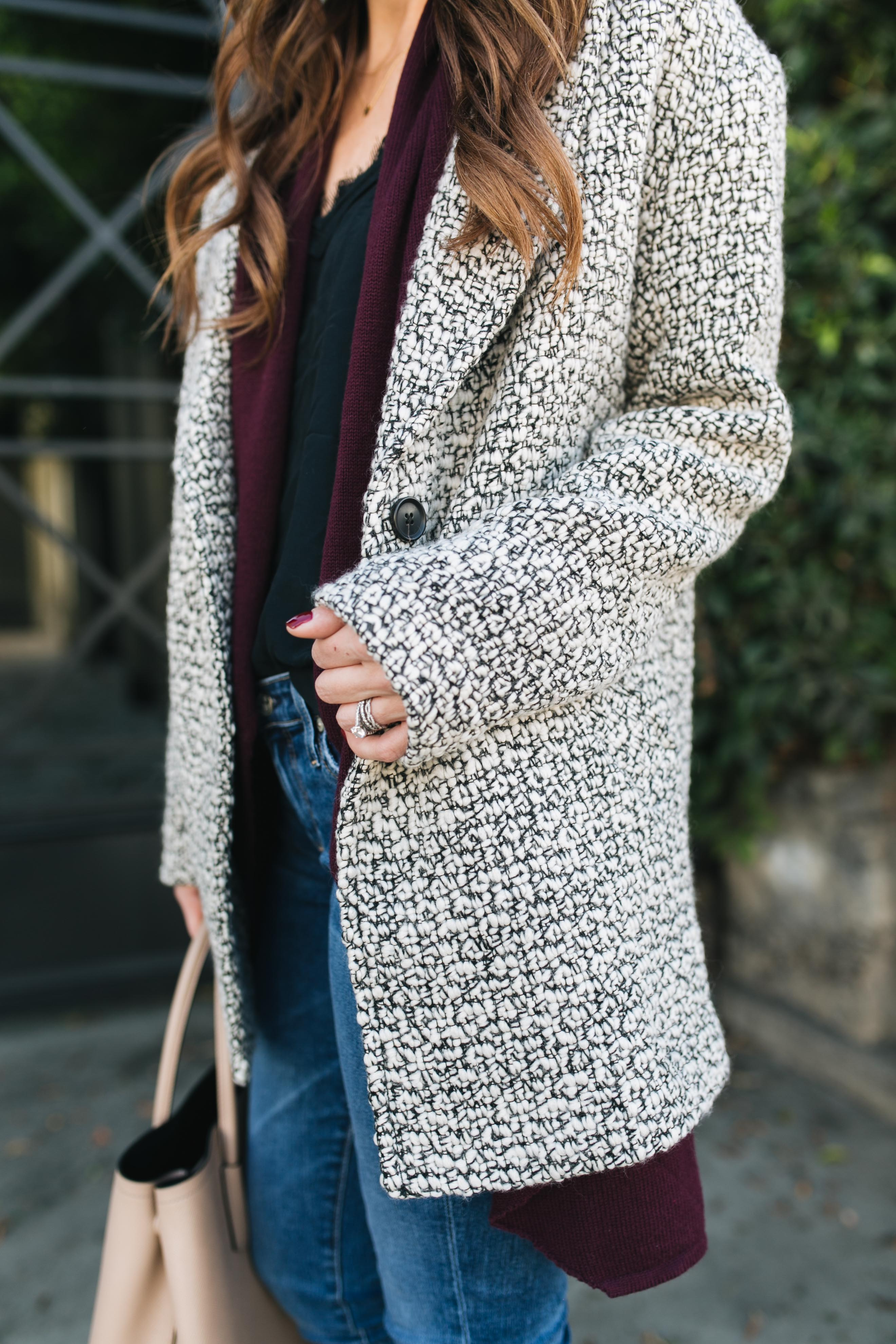 Style blogger Daryl-Ann Denner rounds up top 10 coats under $200 and styles a black and white peacoat layered with a maroon cardigan