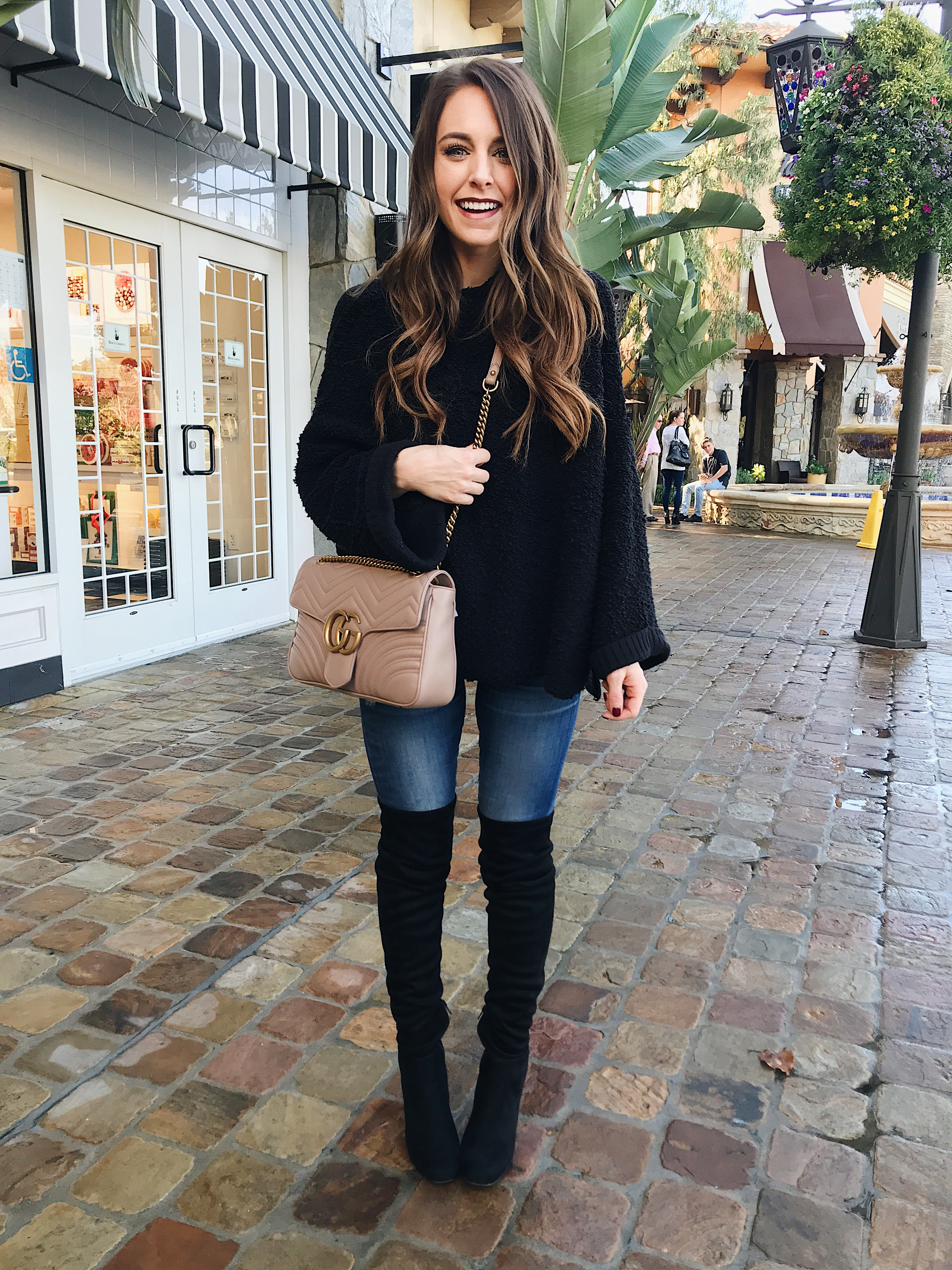 Fashion Blogger Daryl-Ann Denner shares how to wear over-the-knee boots with skirts and jeans