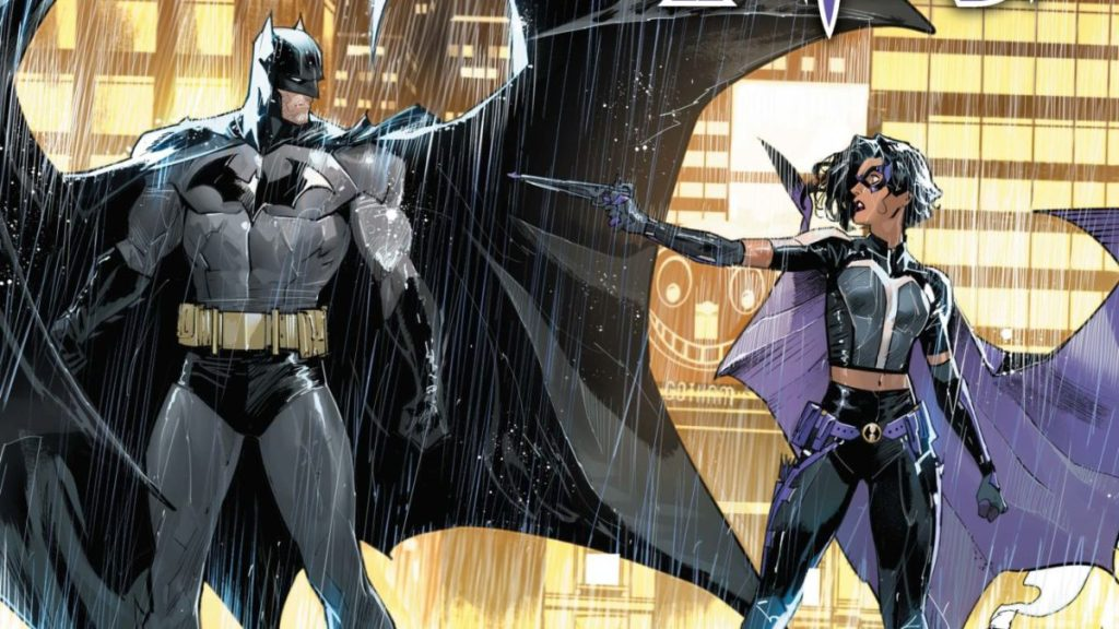 Batman stands beside the Huntress as she points a crossbow at him under the pouring rain.