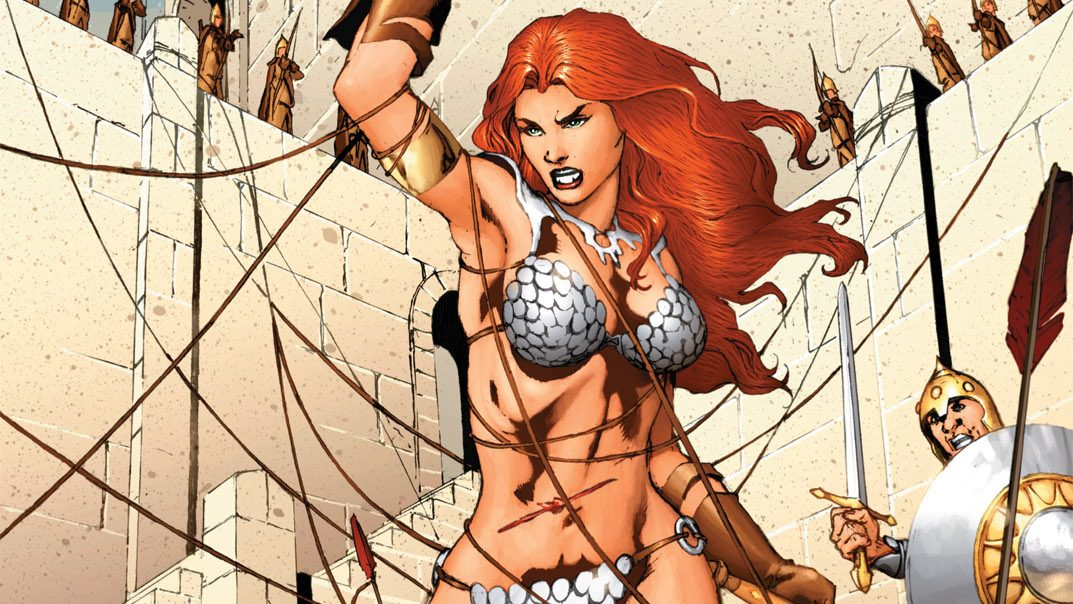 Red Sonja the She-Devil is being attacked by a whole city guard with rope arrows.