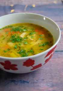 A close up shot of turkey and vegetable soup