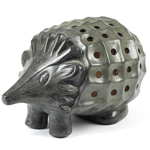 Terra Cotta Trends - Luminary Hedgehog Our hedgehog luminary is handmade of red clay terra cotta from the Baja region of Mexico. Sun-dried and oven-fired. This durable attractive luminary is suitable for either indoor or outdoor use. To illuminate simply insert a candle, battery or electric powered light (not included). Color: Slate (Grey Green)