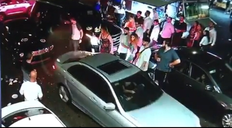 angry woman smashes mercedes