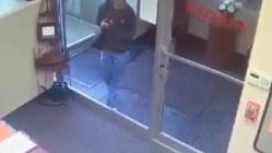 Woman walks into glass window