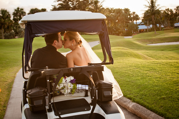 wedding golf cart kiss