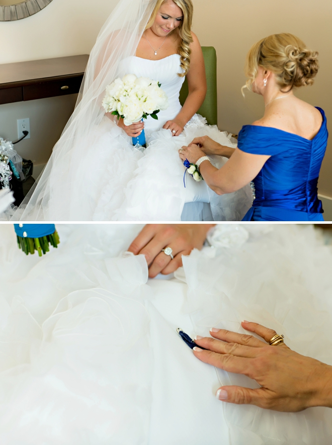 Super sweet 'something blue' pinned into the brides dress