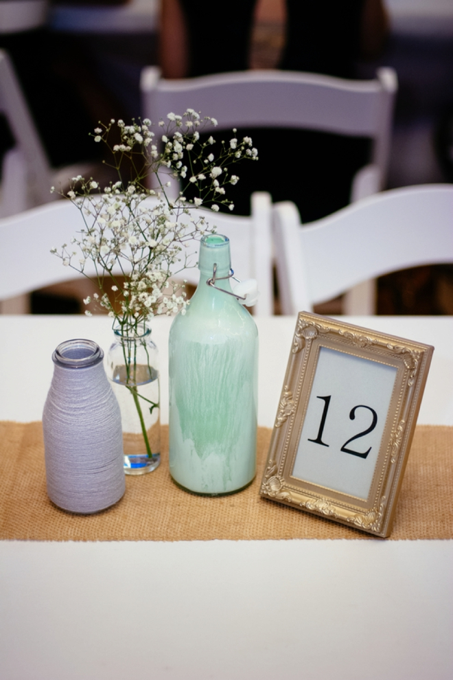 Painted bottle, yarn wrapped bottle and framed table number