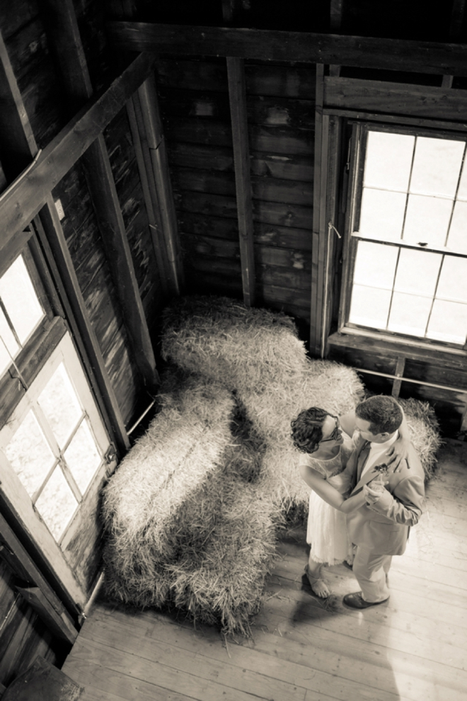 Bride and groom in barn