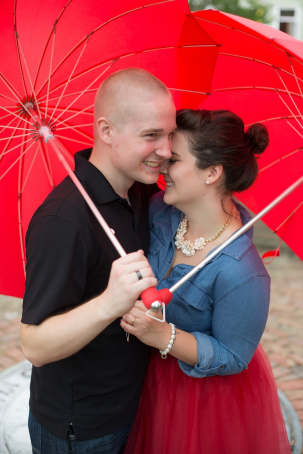 Red heart umbrellas in engagement