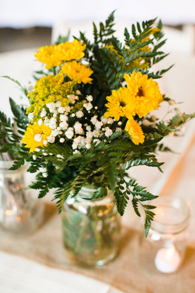 Simple yellow flowers for a barn wedding