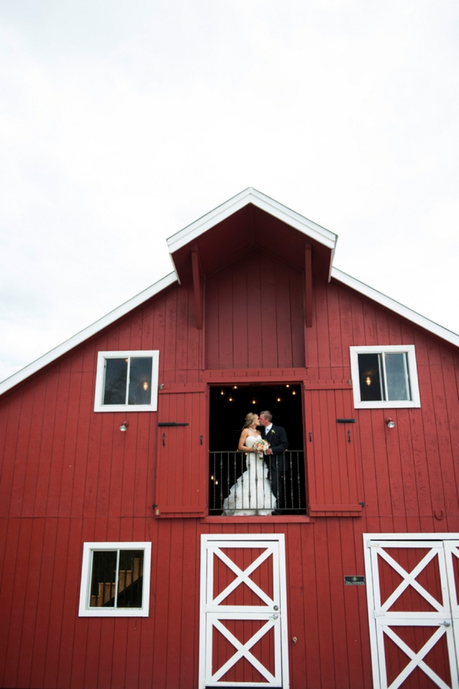 Bride and groom portrait in a barn